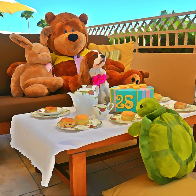 Lady celebrating The Phoenician's 25th Anniversary with the stars of Discover The Phoenician with Phoe-Phoe & Friends (left to right: Phoe-Phoe the cottontail rabbit, Charlie the Bear, Lady the dog, and Tut-Tut the turtle)