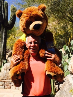 Photographer & photo illustrator, Dan Merchant pals around with The Phoenician's bear, Charlie
